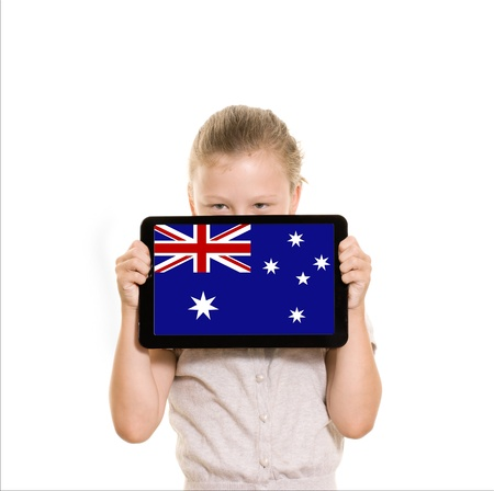 Australian flag on tablet computer held by young girl Stock Photo