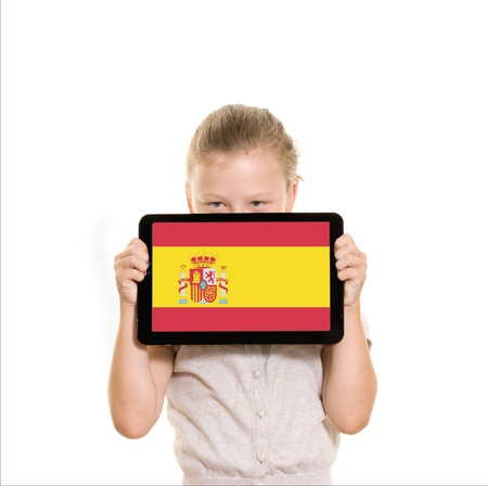 flag of Spain displayed on tablet computer held by young girl