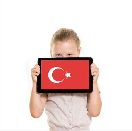 flag of Turkey displayed on tablet computer held by young girl