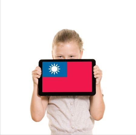 Girl holding tablet pc displaying flag of Taiwan