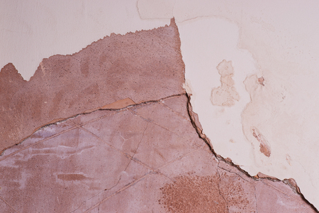 damp: interior wall showing cracked and damaged plaster due to damp