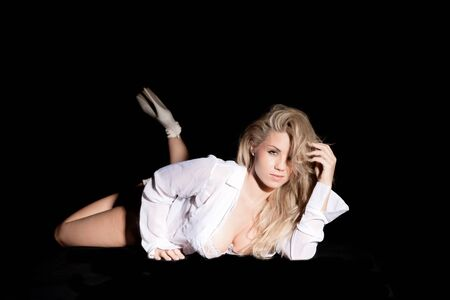 pretty blonde in open shirt on black background
