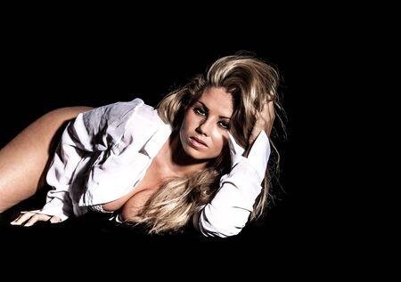 portrait of beautiful blonde woman on black background