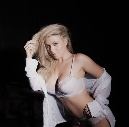 sexy woman in shirt and underwear on black background