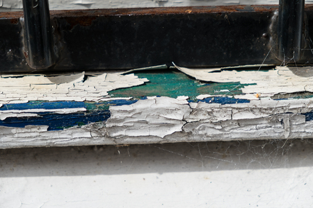 window sill showing cracked and flaking paint