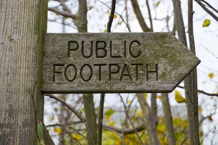 close up of a public footpath sign made of wood