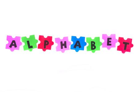 foam letters spelling the word alphabet on white