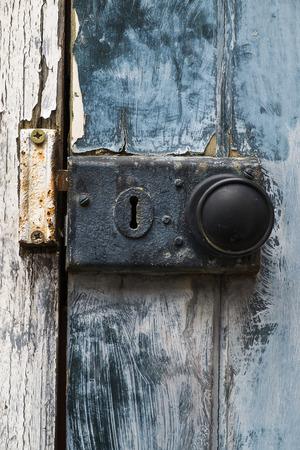 old rusty doorknob and lock on exterior door Stock Photo