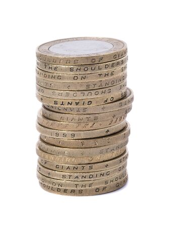 coinage: stacked uk two pound coins on white Stock Photo