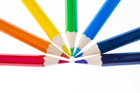 colored pencils forming a rainbow isolated on white Stock Photo