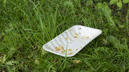 plastic fast food tray littering the countryside Stock Photo