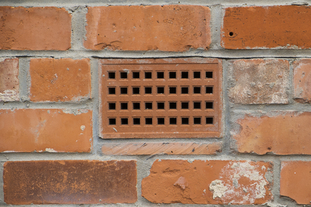 brick wall with a close up showing a ventilation brick