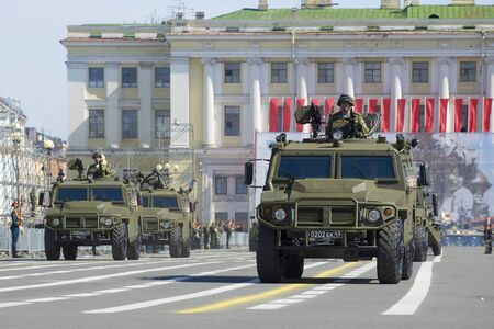 a rehearsal: ST. PETERSBURG, RUSSIA - MAY 05, 2015: Column multi-purpose armored vehicles Tigr on rehearsal of parade in honor of Victory Day Editorial