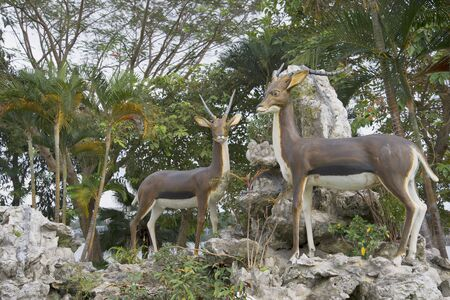 hue: HUE, VIETNAM - DECEMBER 15, 2015: Sculptures of deer in the city Park of hue city