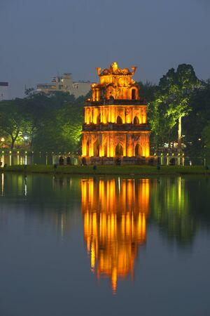 returned: The tower on the Hoankiem lake at night. Hanoi, Vietnam