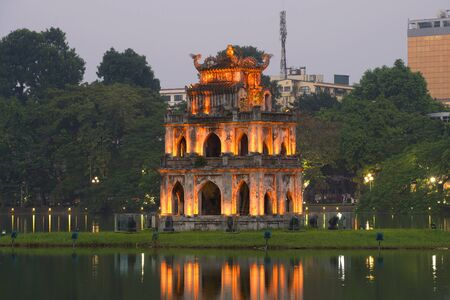 returned: Temple on lake in the twilight. Hanoi, Vietnam