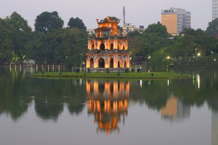 returned: View of the temple of the turtles in the early evening twilight. Hanoi, Vietnam