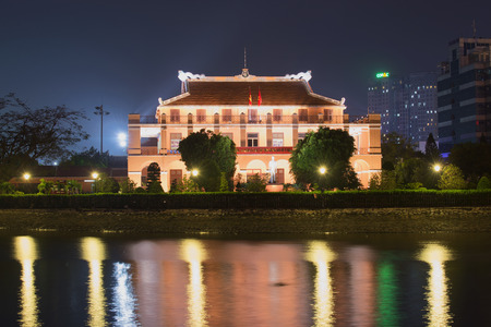 The landscape of Saigon: HO CHI MINH CITY, VIETNAM - DECEMBER 20, 2015: The Ho Chi Minh Museum on the banks of the river at night
