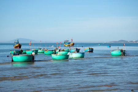 fishing fleet: MUI NE, VIETNAM - DECEMBER 25, 2015: Fleet round boats after fishing in the Fishing harbour