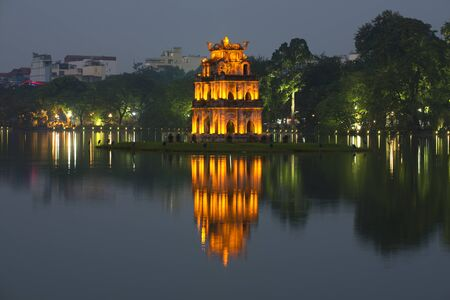 returned: Temple turtle on the restored sword lake in the late evening. Hanoi, Vietnam