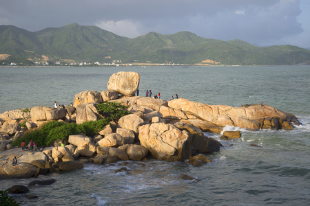 hon: NHA TRANG, VIETNAM - DECEMBER 30, 2015: People are walking over boulders in a Stone garden Hon Chong Editorial