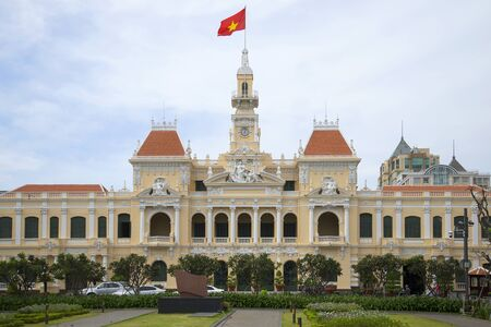 HO CHI MINH CITY, VIETNAM - DECEMBER 19, 2015: Developing the flag on the facade of the city hall in Ho Chi Minh city