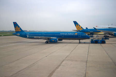 airbus: HANOI, VIETNAM - JANUARY 12, 2016: Airbus A321 VN-A602 Vietnam Airlines transported to the runway. Noibai Airport