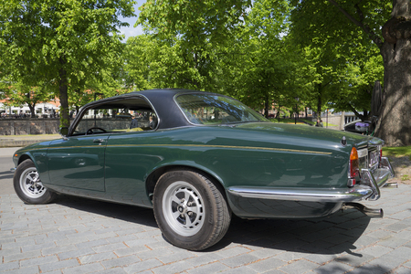 daimler: TURKU, FINLAND - JUNE 13, 2015: The two-door Jaguar XJ12c, Daimler Double Six Coupe in the rally of owners of Jaguar cars in Turku