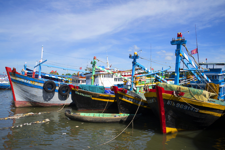 schooner: PHAN THIET, VIETNAM - DECEMBER 24, 2015: Fishing schooner in the harbor of Phan Thiet are preparing to put to sea Editorial