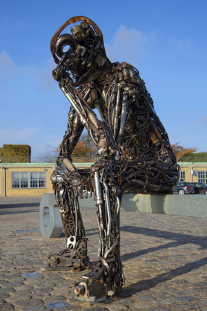 metal parts: COPENHAGEN, DENMARK - NOVEMBER 03 2014: The sculpture of iron man closeup is on the waterfront of the city of Copenhagen