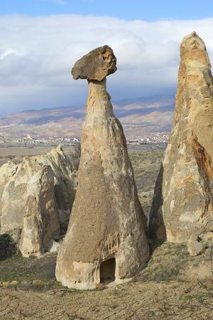 vicinity: Mushroom rock in the vicinity of Cappadocia january day. Turkey