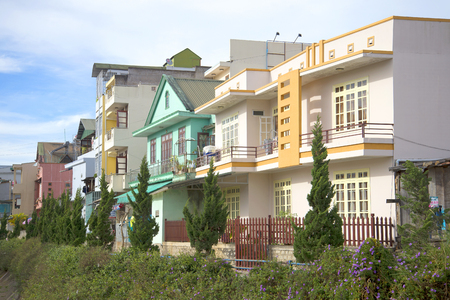 dalat: DALAT, VIETNAM - DECEMBER 28, 2015: Street with new modern houses in Da Lat. Modern cottages built for young families