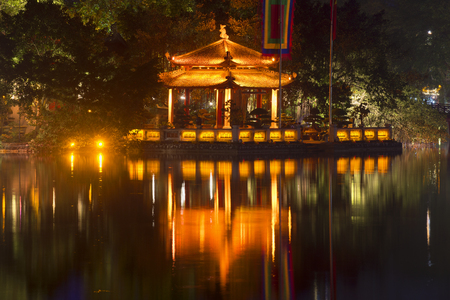 returned: Jade Temple on Hoan Kiem Lake in the night illumination close-up. Hanoi, Vietnam