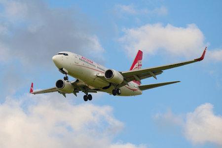 airways: ST. PETERSBURG, RUSSIA - JULY 24, 2015: The Boeing 737-700 (4L-TGM) of the company Georgian Airways on glide path