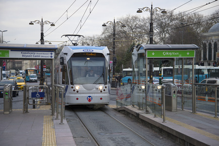 electric tram: ISTANBUL, TURKEY - JANUARY 02, 2015: The T1 tram arrives at the stop Beyazit Kapalicarsi