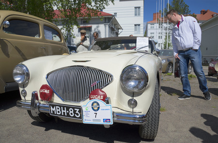 man s: SAVONLINNA, FINLAND - JUNE 06, 2015: The car Austin-Healey-100 Le Man s 1955 the parade of vintage cars