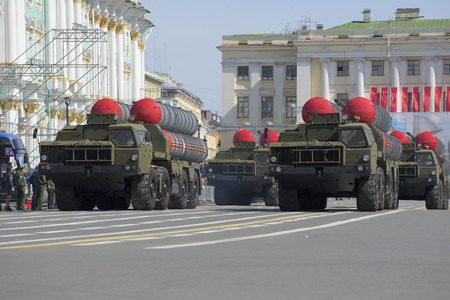 convoy: ST. PETERSBURG, RUSSIA - MAY 05, 2015: A convoy of rocket launchers S-300PM in the march on the Palace square. Rehearsal of parade in honor of Victory Day Editorial