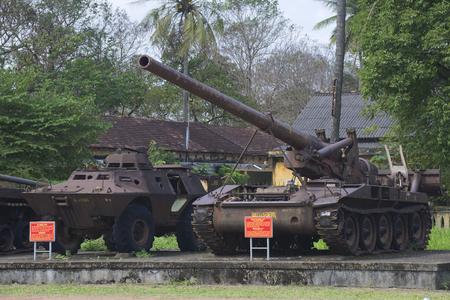 hue: HUE, VIETNAM - JANUARY 08, 2016: An armored personnel carrier and 175 mm self-propelled artillery installation in the city of Hue