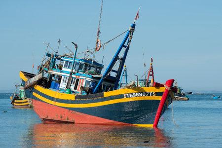 ne: MUI NE, VIETNAM - DECEMBER 25, 2015: Fishing schooner was preparing to go to sea. In the fishing harbour of Mui Ne Editorial