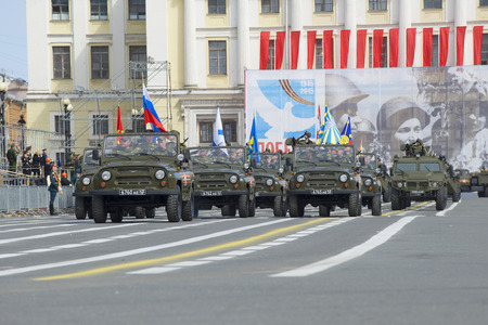 a rehearsal: ST. PETERSBURG, RUSSIA - MAY 05, 2015: The Banner Group on cars UAZ-469 at a rehearsal of the Victory Parade Editorial