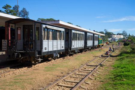dalat: DALAT, VIETNAM - DECEMBER 27, 2015: Tourist retro train at the station of Dalat. Old railroad Vietnam
