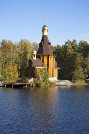 apostle: The wooden Church of the Apostle Andrew on Vuoksa gold autumn. Leningrad region, Russia Stock Photo