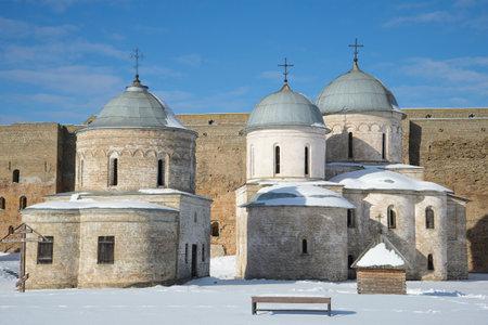 assumption: Ancient Assumption and St. Nicholas church in the Ivangorod fortress winter day. Leningrad region, Russia