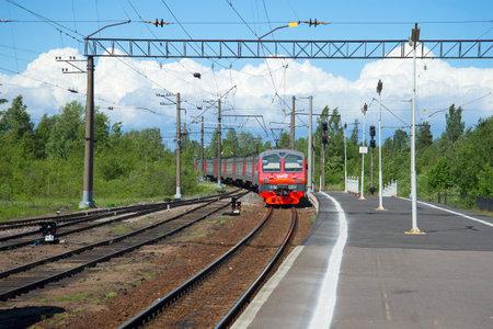 arrives: LENINGRAD REGION, RUSSIA - JUNE 08, 2015: Train from Saint Petersburg arrives at the station Petrokrepost