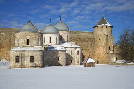assumption: Assumption and St. Nicholas Church at the gate towers, winter day. Ivangorod, Leningrad region, Russia