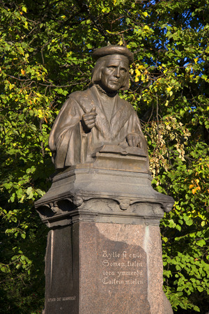 vyborg: VYBORG, RUSSIA - OCTOBER 11, 2015: Monument to Mikael Agricola october afternoon