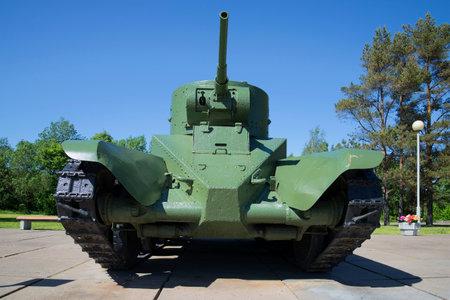 speed gun: LENINGRAD REGION, RUSSIA - JUNE 08, 2015: Soviet wheeled-tracked fast tank BT-5 in Museum-diorama break of Leningrad blockade on a summer day