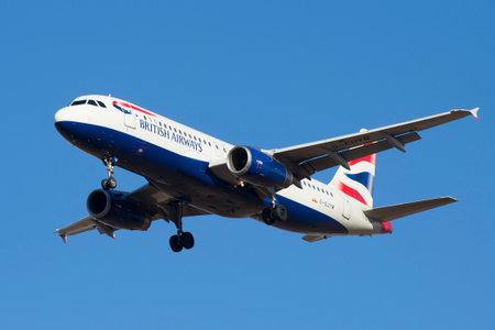 british weather: ST. PETERSBURG, RUSSIA - MARCH 20, 2016: Airbus A320-232 (G-EUYM) British Airways in flight