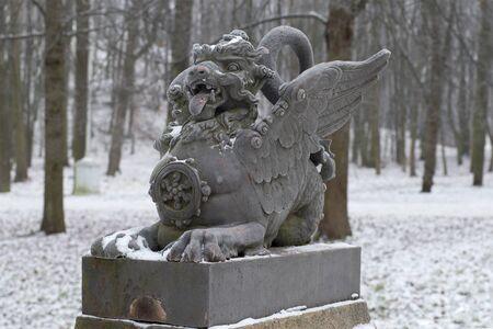 tsarskoye: The sculpture of the dragon on the bridge closeup gloomy winter day. Tsarskoye Selo, Russia