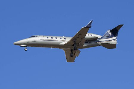 bombardier: SAINT PETERSBURG, RUSSIA - MARCH 20, 2016: The Bombardier Learjet 60 (ES-LVA) airlines Panaviatic before landing in Pulkovo airport